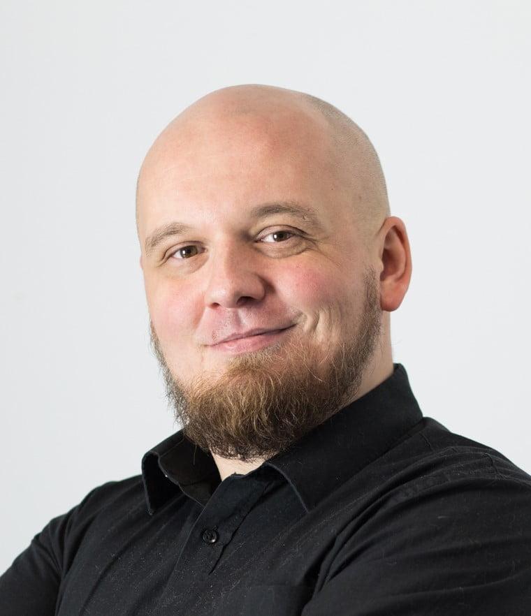 Paweł Oziemczyk - zdjęcie portretowe, ilustracja do cytatu na temat roli pozyskiwania opinii w sklepie internetowym.